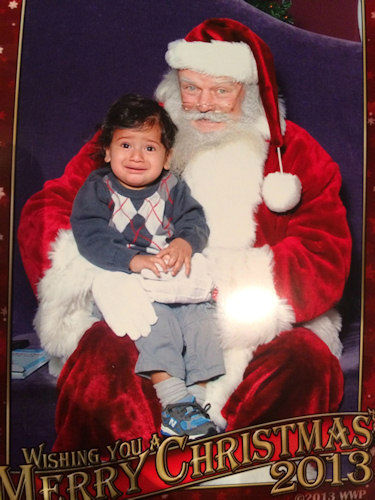 Austin's not too happy to meet Santa.