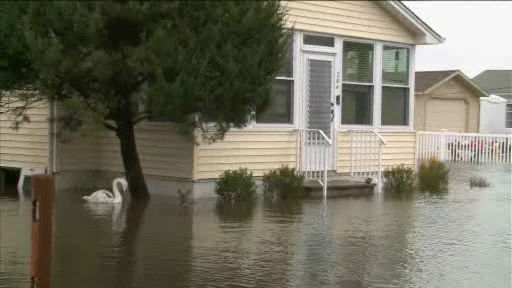 "<div class=""meta image-caption""><div class=""origin-logo origin-image ""><span></span></div><span class=""caption-text"">Photos of storm damage and flooding in parts of New Jersey on Friday, December 21, 2012.</span></div>"