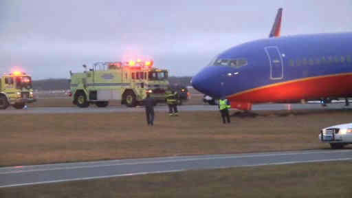 "<div class=""meta image-caption""><div class=""origin-logo origin-image ""><span></span></div><span class=""caption-text"">A Southwest plane ended up in the mud at MacArthur Airport on Long Island.</span></div>"