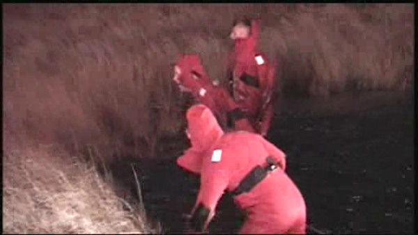 Rescuers pulled 4 people from the water after their car plunged into a marsh near Kennedy Airport Sunday morning.
