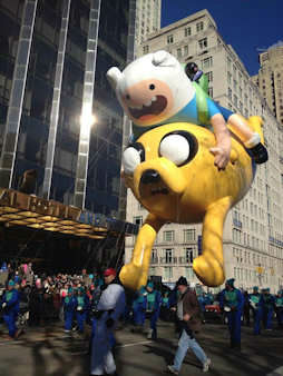 The big balloons soared along with the crowd's spirits Thursday as the annual Macy's Thanksgiving Day Parade made its way through the streets of New York City. There'd been some concerns about whether the wind could keep 16 giant balloons grounded, but the cherished tradition prevailed.