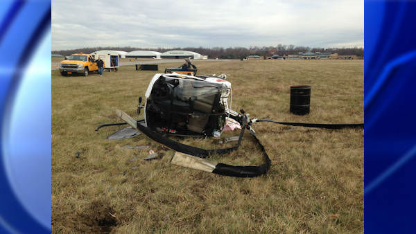 Two people escaped with minor injuries when a helicopter crashed while trying to land at Westchester County Airport Saturday morning.