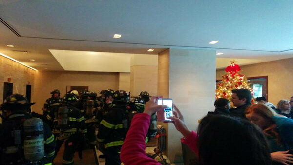 Photos of firefighters in hallway by building resident Rich Rizzo.