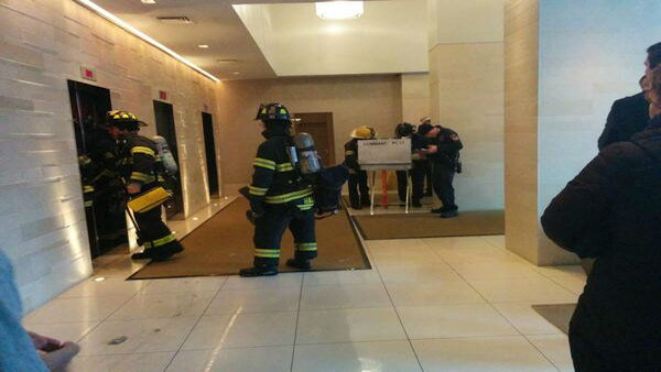 Photo of firefighters in hallway by building resident Rich Rizzo.