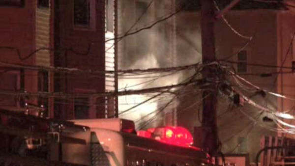 A family of four was forced to jump out a second floor window when fire broke out in their Yonkers home early Wednesday morning.