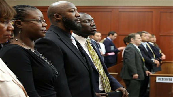 Trayvon Martin&#39;s parents Sabrina Fulton, second left, and Tracy Martin, second right, stand following the state&#39;s closing arguments in George Zimmerman&#39;s trial in Seminole circuit court in Sanford, Fla. Thursday, July 11, 2013. Zimmerman has been charged with second-degree murder for the 2012 shooting death of Trayvon Martin. &#40;AP Photo&#47;Orlando Sentinel, Gary W. Green, Pool&#41; <span class=meta>(AP Photo &#47; Gary W. Green)</span>