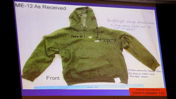 "<div class=""meta ""><span class=""caption-text "">Trayvon Martin' s hooded sweatshirt is displayed on the screen during George Zimmerman's trial at the Seminole circuit court, in Sanford, Fla., Wednesday, July 3, 2013. Zimmerman is charged with second-degree murder in the fatal shooting of Trayvon Martin, an unarmed teen, in 2012. (AP Photo/Orlando Sentinel, Jacob Langston, Pool)   (AP Photo / Jacob Langston)</span></div>"