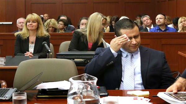 George Zimmerman wipes his face after arriving in the courtroom during his trial at the Seminole County Criminal Justice Center, in Sanford, Fla., Friday, July 12, 2013. Zimmerman is charged in the 2012 shooting death of unarmed teenager Trayvon Martin.  <span class=meta>(AP Photo&#47;Orlando Sentinel, Joe Burbank, Pool)</span>
