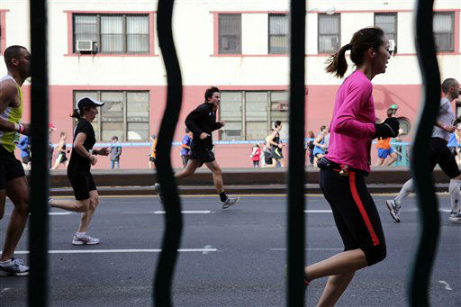 "<div class=""meta ""><span class=""caption-text "">Runners, seen through bars on a subway entrance, move up Fourth Avenue in the Brooklyn borough of New York during the New York City Marathon, Sunday, Nov. 3, 2013. (AP Photo/Peter Morgan)</span></div>"