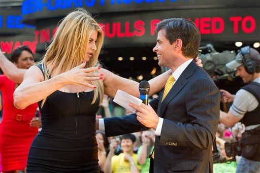 Kirstie Alley and George Stephanopoulos dance on Good Morning America in New York, Wednesday, May 25, 2011. (AP Photo/Charles Sykes)