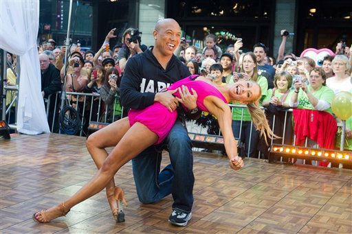 Dancing with the Stars winners Hines Ward and Kym Johnson dance on Good Morning America in New York, Wednesday, May 25, 2011. (AP Photo/Charles Sykes)