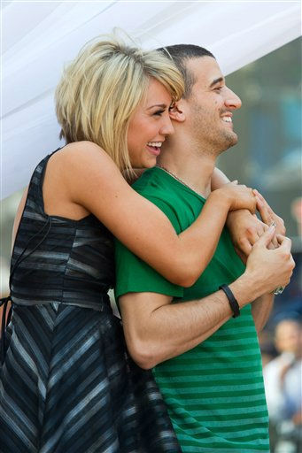 Dancing with the Stars finalists Chelsea Kane and Mark Ballas appear on Good Morning America in New York, Wednesday, May 25, 2011. (AP Photo/Charles Sykes)