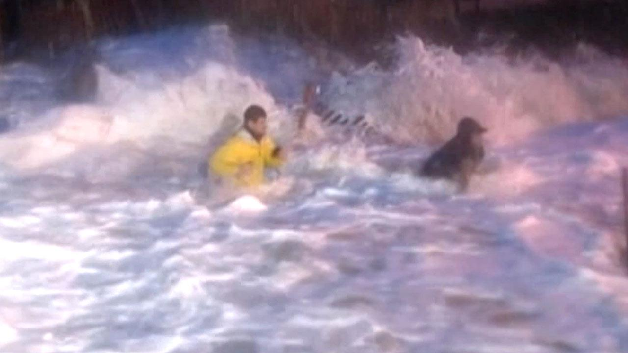 ABC News reporter Matt Gutman (left) and his producer were swept by waves while reporting on superstorm Sandy in North Carolina on Monday, Oct. 29, 2012.