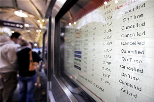 Canceled flights are displayed on a monitor at Reagan National Airport in Arlington, Va., as a winter storm heads up the East coast on Sunday, Dec. 26, 2010. &#40;AP Photo&#47;Jacquelyn Martin&#41; <span class=meta>(AP Photo&#47; Jacquelyn Martin)</span>