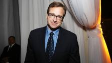 (File) Bob Saget attends the 2nd Annual Rebels with a Cause at Paramount Pictures Studios on Thursday, March 20, 2014 in Los Angeles. - Provided courtesy of AP / (Photo by Annie I. Bang /Invision/AP)
