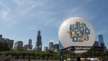 (FILE) A Lollapalooza balloon floats between stages at the Lollapalooza Festival in Chicago in June 2013.  - Provided courtesy of AP Photo/Scott Eisen, File