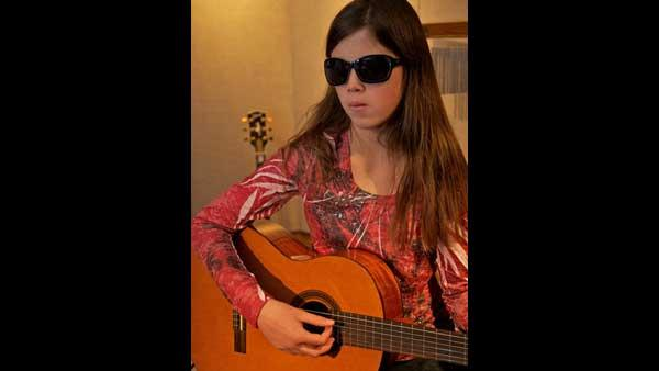 Young, blind singer debuts Christmas song on WCL