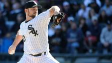 Chicago White Sox relief pitcher David Robertson (30) pitches against the Minnesota Twins during the ninth inning of a baseball game, Saturday, April 11, 2015 in Chicago.(FILE) - Provided courtesy of AP / David Banks