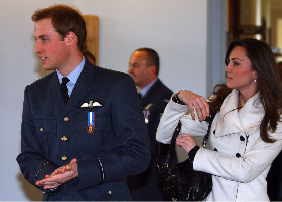 Britain&#39;s Prince William, left, walks with his girlfriend Kate Middleton after his graduation ceremony at RAF Cranwell, in Cranwell, England on April 11, 2008. Prince William was presented with his ceremonial pilot&#39;s wings Friday by his father Prince Charles, as he graduated as a military pilot and followed in the footsteps of a host of his royal ancestors. The young prince&#39;s girlfriend Kate Middleton and his father&#39;s wife, Camilla, watched on as William passed out with his class of colleagues. &#40;AP Photo&#47;Paul Ellis, Pool&#41; <span class=meta>(AP Photo&#47; PAUL ELLIS)</span>