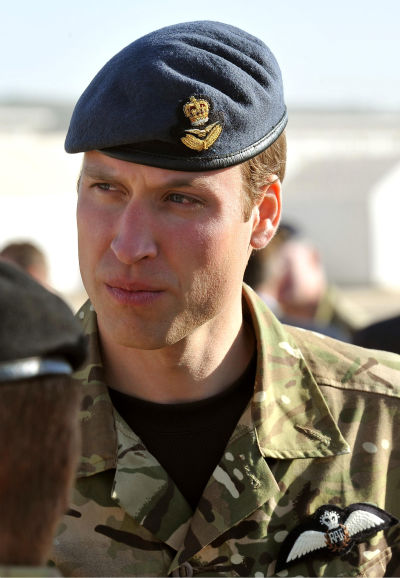 Britain&#39;s Prince William talks to soldiers before a remembrance day ceremony at Camp Bastion in southern Afghanistan, Sunday Nov. 14, 2010. Clarance House announced in London, Tuesday Nov. 16, 2010, that Prince William and Kate Middleton are engaged, and will be married in 2011. &#40;AP Photo&#47;John Stillwell, pool&#41; <span class=meta>(AP Photo&#47; John Stillwell)</span>
