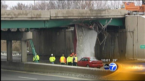 Truck slams into bridge along Bishop Ford