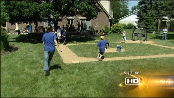 family friends enjoy wiffle ball field null