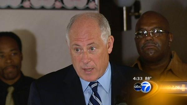 Quinn marches against violence, for black vote