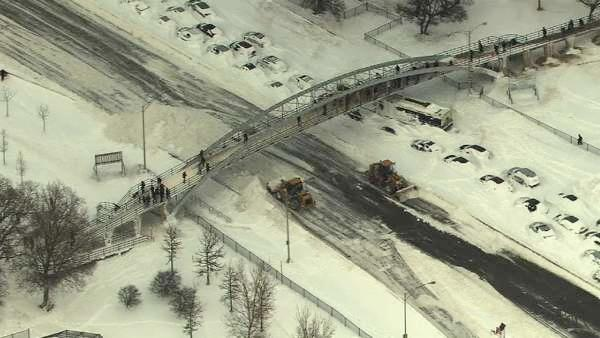 A bus and other vehicles remained stuck Wednesday afternoon in the snowy northbound lane of Lake Shore Drive under the North Avenue Beach pedestrian bridge.
