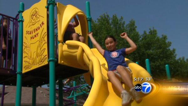 Volunteers donate time to build playground