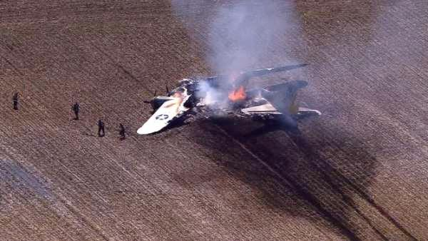 A WWII bomber plane crashed and caught fire in far west suburban Oswego Monday morning, June 13, 2011.
