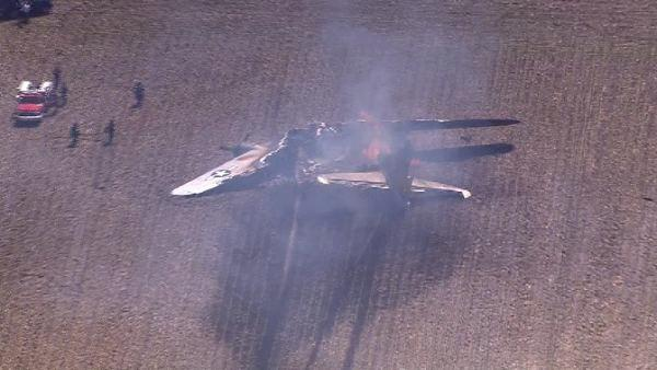 A WWII bomber plane crashed and caught fire in far west suburban Oswego Monday morning, June 13, 2011. (Chopper 7 HD i