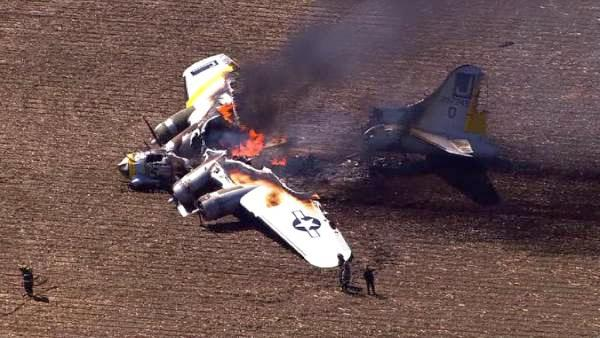 A WWII bomber plane crashed and caught fire in far west suburban Oswego Monday morning, June 13, 2011. (Chopper 7 HD image)