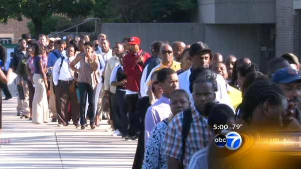 Job seekers line up outside job fair