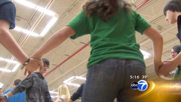 Middle school students aim for square dance record