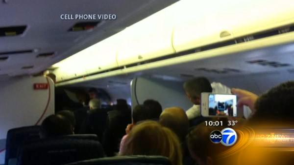 Flight attendant removed from plane after rant