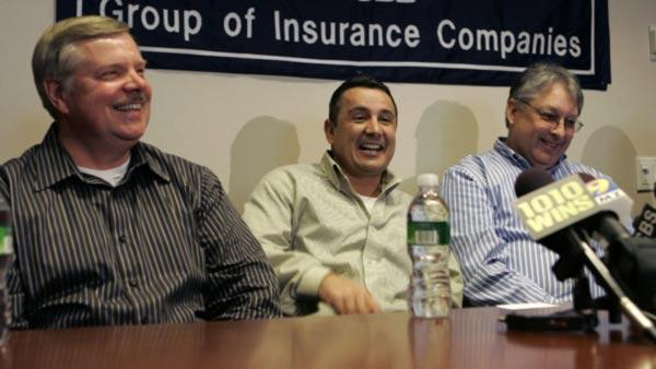 Three of the 10 co-winners of the $216 million Mega Millions lottery, Bob Space, 60, of Toms River, N.J., left, Oscar Oviedo, center, of Stewartsville, N.J., and Jerry Solas of Hillsborough, N.J., laugh during a news conference