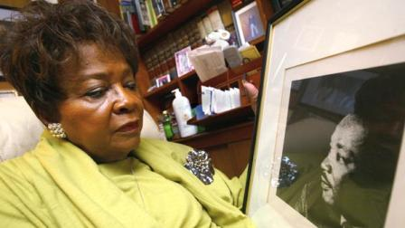 Addie Wyatt looks at a framed photo of her friend, slain civil rights leader the Rev. Martin Luther King Jr. at her Chicago home on Thursday, Jan. 13, 2005.     (AP Photo/Nam Y. Huh)