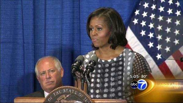 Michelle Obama in Chicago for bill signing, fundraising