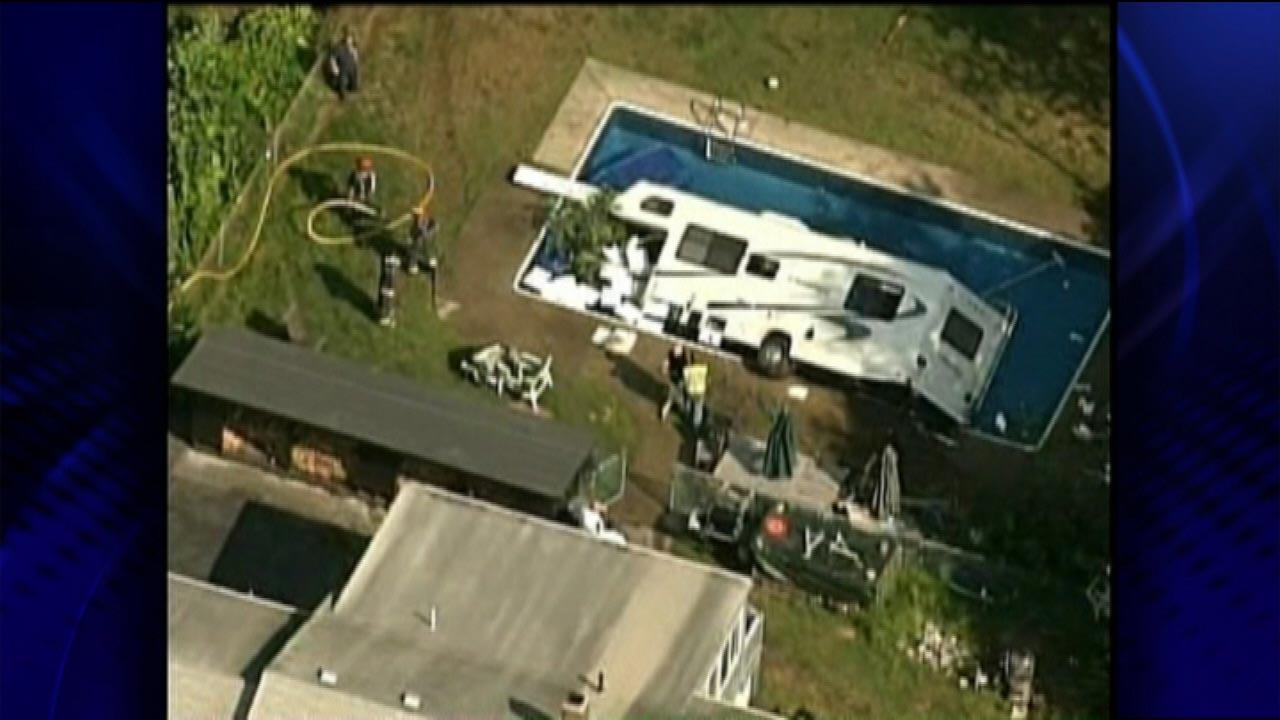 A crane was also called in to help get the camper out of the pool.