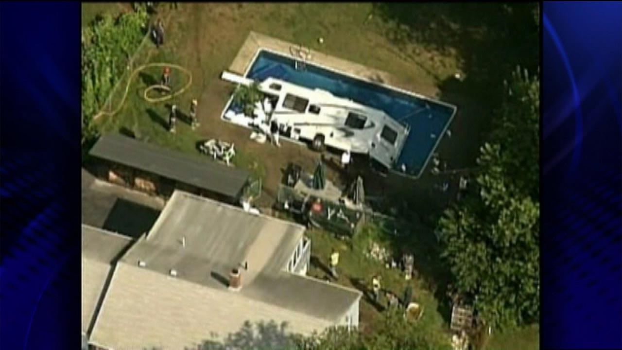 An unusual sight in Brockton, Massachusetts: A 30-foot found RV crashed into a swimming pool.