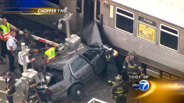 Brown Line service restored after police car hits train