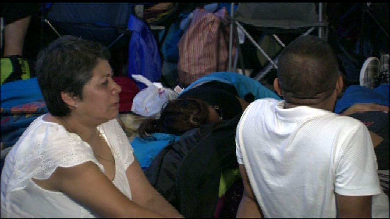 Hundreds of people lined up at the Navy Pier Grand Ballroom on Wednesday morning, August 15, 2012, to register for a new program that will keep them from being deported. Some began lining up as early as 11 p.m. Tuesday night. <a hrefhttp://abclocal.go.com/wls/story?sectionnews/local&id8774282>Read more</a>.