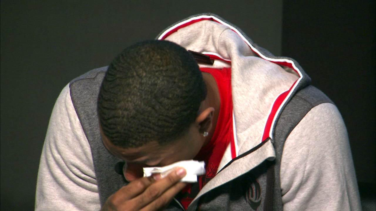 Chicago Bulls Derrick Rose breaks down and cries during a news conference unveiling his new shoe the Adidas D Rose 3 in Chicago, Thursday, Sept. 13, 2012.