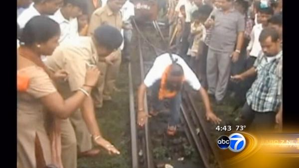 Indian man pulls 40-ton train with ponytail