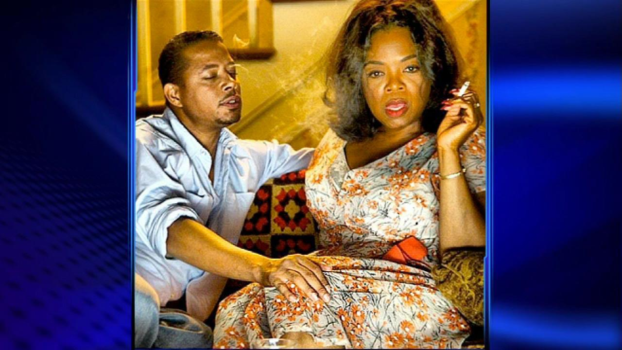 Oprah Winfrey is photographed smoking a cigarette, with a mans hand on her leg, and it wasnt Stedmans.