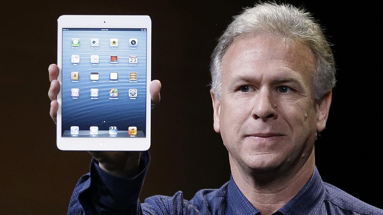 Phil Schiller, Apples senior vice president of worldwide product marketing, introduces the iPad Mini in San Jose, Calif., Tuesday, Oct.  23, 2012. (AP Photo/Marcio Jose Sanchez)