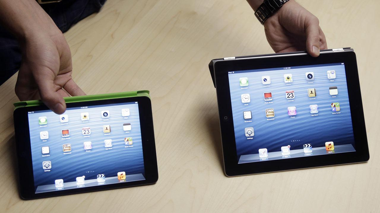The iPad Mini, at left, is shown next to the 4th Generation iPad in San Jose, Calif. (AP Photo/Marcio Jose Sanchez)