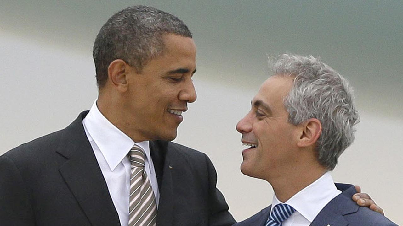 President Barack Obama is greeted by Chicago Mayor Rahm Emanuel on the tarmac upon his arrival on Air Force One at OHare International Airport in Chicago, Thursday, Oct. 25, 2012. The president is taking a break from his 48 hour, 8 state campaign blitz, to cast his vote, during early voting today at a local community center in Chicago. (AP Photo/Pablo Martinez Monsivais)
