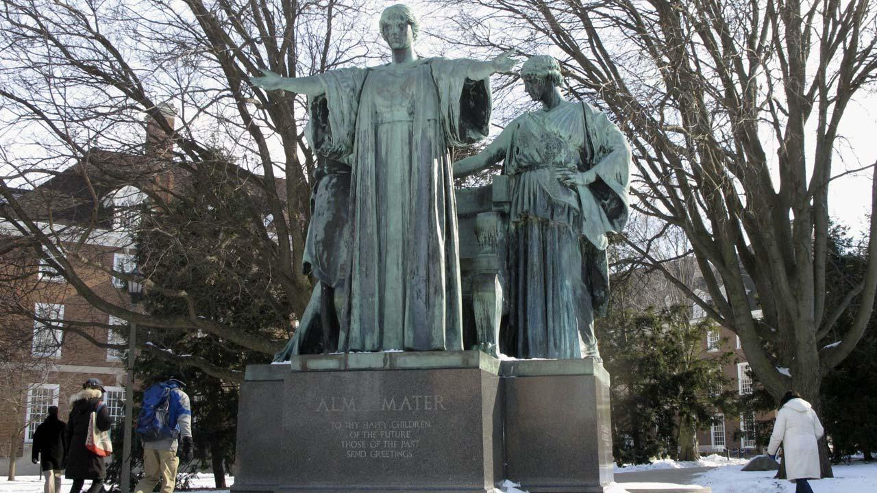 Pedestrians walk past the Alma Mater statue on the University of Illinois campus in Urbana, Ill., on Wednesday, Jan. 6, 2010.  (AP Photo/David Mercer)