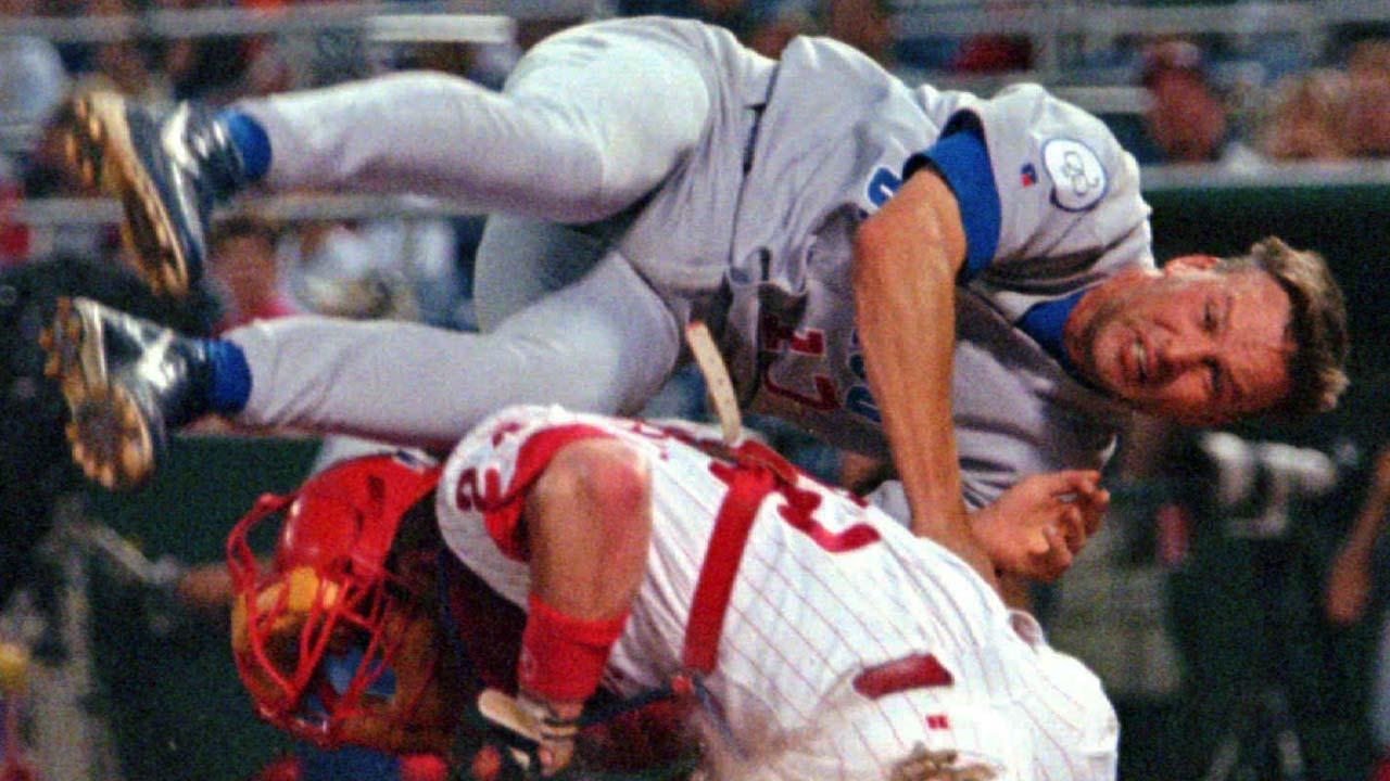 Chicago Cubs Mark Grace rolls over Philadelphia Phillies catcher Mike Lieberthal in the second inning of Friday , June 12, 1998 game in Philadelphia.Grace was out trying to score from second on a single.(AP Photo/George Widman)